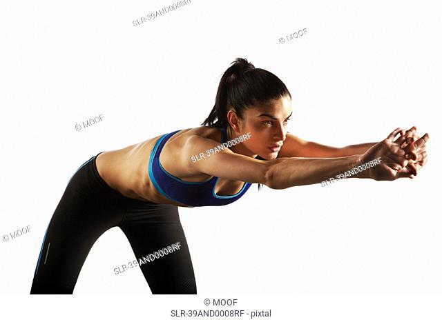 Athlete stretching at waist