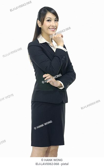 Businesswoman thinking with her hand on her chin