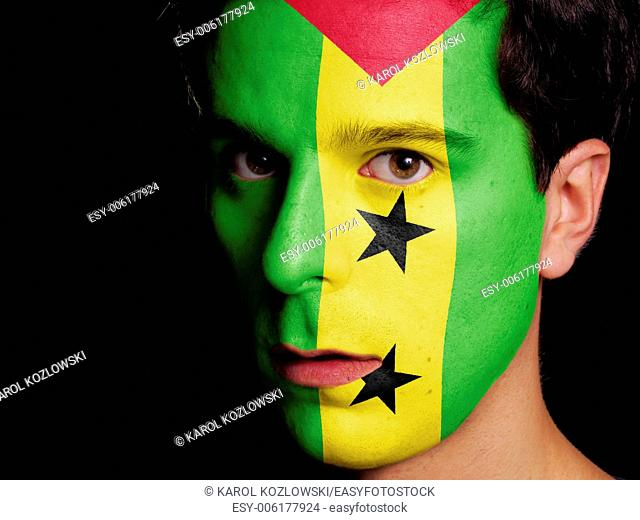 Flag of Sao Tome and Principe Painted on a Face of a Young Man