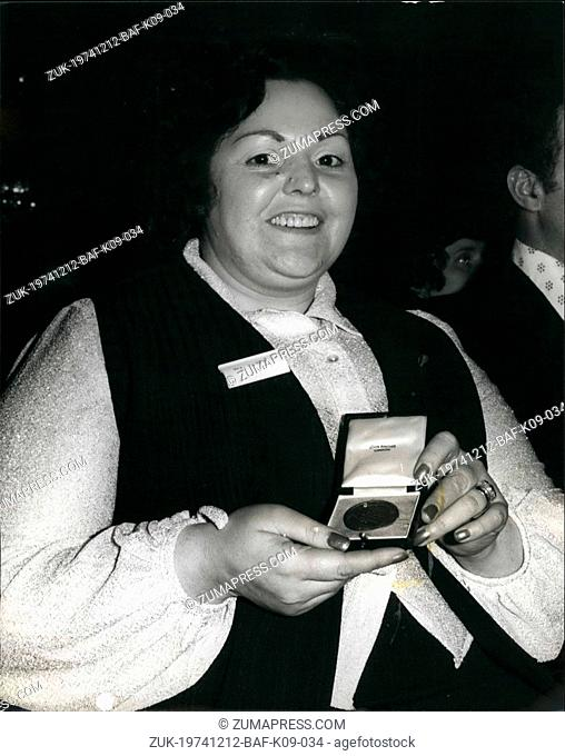 Dec. 12, 1974 - Women Who Tried To Stop Armed Gang Wins Binney Medal: Shots were fired at Mrs Jessie Burns by a gunman leaning out of the geteway car when she...