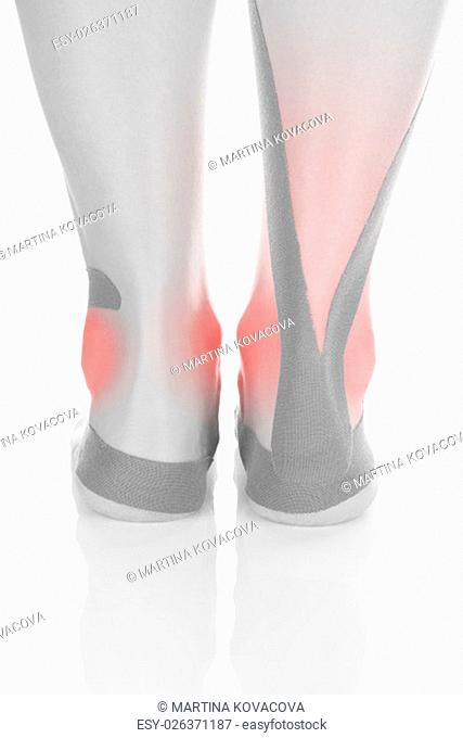 Therapeutic tape on female heel isolated on white background. Chronic pain, alternative medicine. Rehabilitation and physiotherapy
