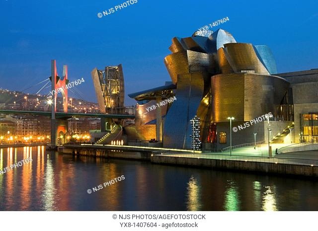 """Night view of Guggenheim Museum and the scuplture """"Tall tree and the eye"""" by Anish Kapoor with """"La Salve"""" bridge on the background, Bilbao, Vizcaya"""