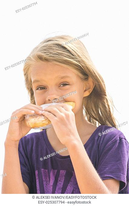 A hungry girl with an appetite for biting a delicious pie