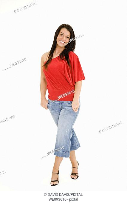 A beautiful young female caucasian wearing an casual outfit  She is on a white background