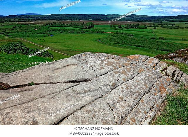 Scotland Kilmartin Glen, remains of the former fort Dun, Dunadd or Fort Hill, Rock plate with a footprint on the hill of the fort