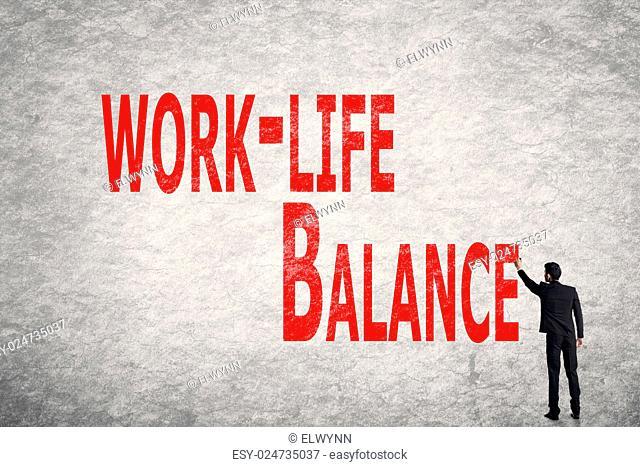 Asian business man write words on wall, Work-Life Balance