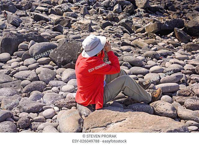 Bird Watcher Watching for Birds on Espanola Island in the Galapagos