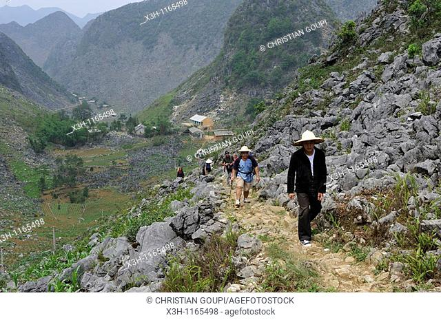 trekkers on mountain's path,around Sa Phin,Dong Van plateau,Ha Giang province,northern Vietnam,southeast asia