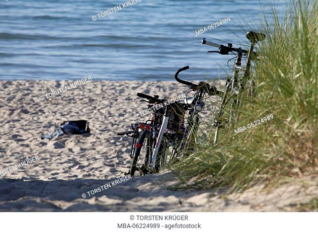 Rostock-Warnemünde, Parked bikes in the dunes on the beach