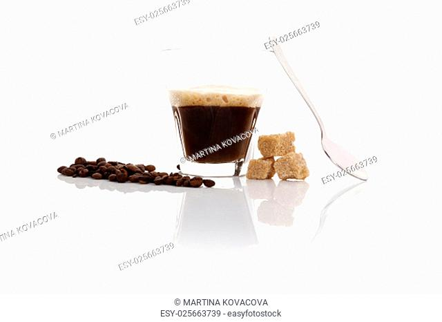 Espresso with coffee beans, brown crane sugar and spoon isolated on white background. Traditional coffee drinking