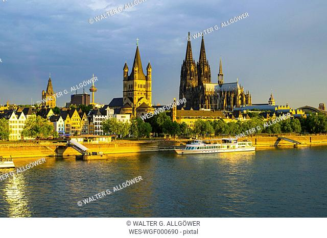 Germany, Cologne, View to Townhall, Colonius, Great St Martin, Cologne dome, Old town riverside, Rhine river in the evening