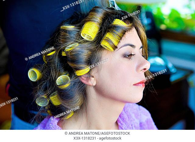 Woman's hair on curlers