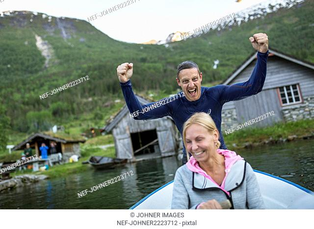 Happy man and woman on rowing boat