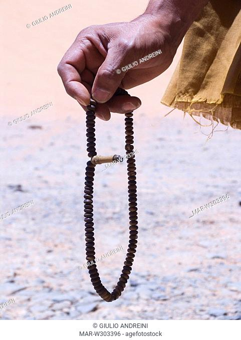 africa, libya, akakus, man with his rosary