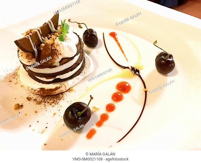 Chocolate cake and cream dessert