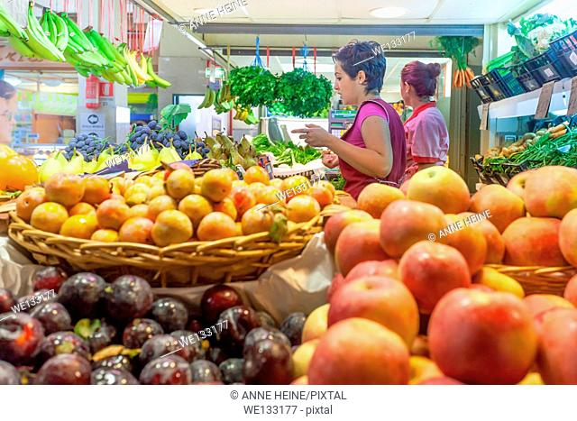 Women working at fruit stand, Cagliari, Sardeian, Italy