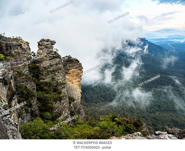 Australia, New South Wales, Katoomba, Large rocks and mountains in clouds