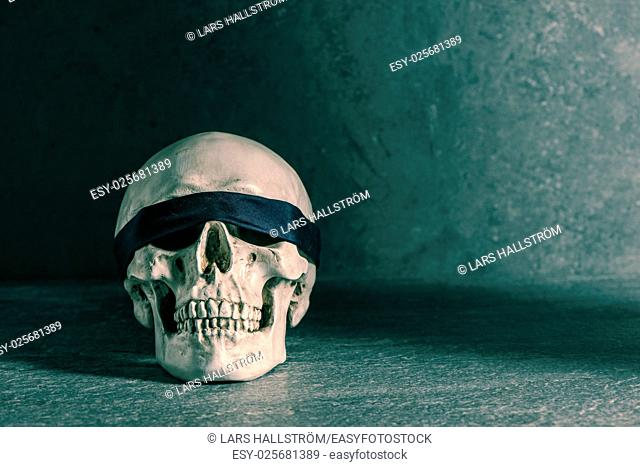 Human skull with blindfold. Concept of death, horror and execution. Spooky halloween symbol