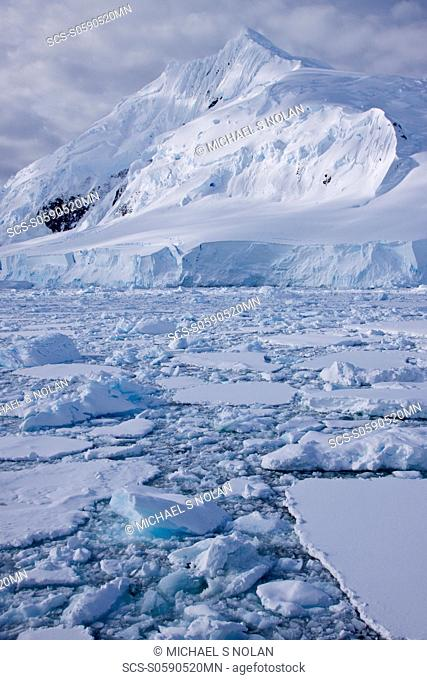 The Lindblad Expeditions ship National Geographic Explorer pushes through ice in Crystal Sound, south of the Antarctic Circle, Antarctica