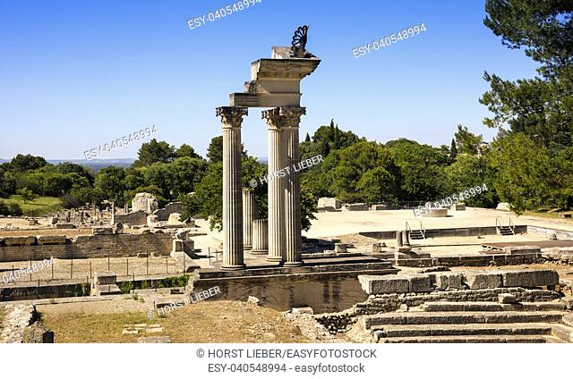 Restored columns of twin Corinthian temple in first Roman Forum of Glanum. Saint Remy de Provence, Bouches du Rhone, Provence, France