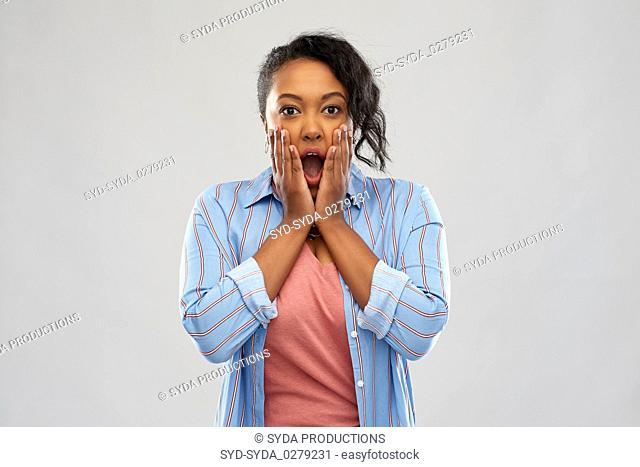 shocked african american woman with open mouth