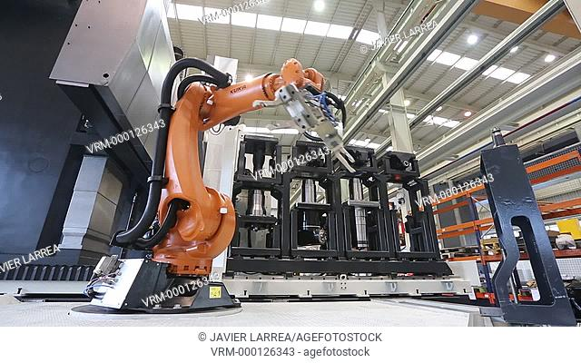 Robot tool changer. Machining Center. CNC. Gantry mobile milling machine. Guided hydrostatic axis. Design, manufacture and installation of machine tools