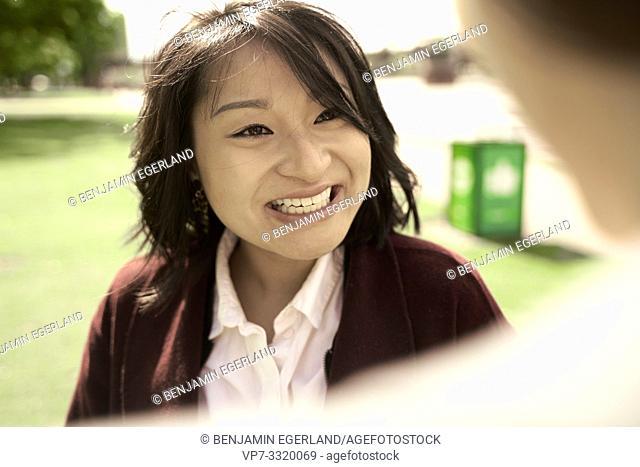Asian woman looking at counterpart, in Frankfurt am Main, Germany