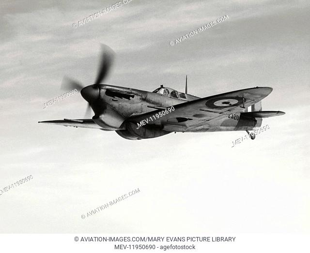 Royal Air Force RAF Supermarine Spitfire 5C Flying Enroute with Tropical Type Air-Intake and a Slipper Type 170 Gallon Auxilliary Fuel-Tank