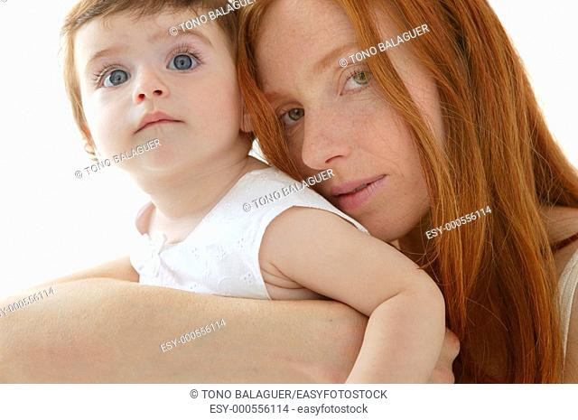 baby brunette and redhead mother love hug on white