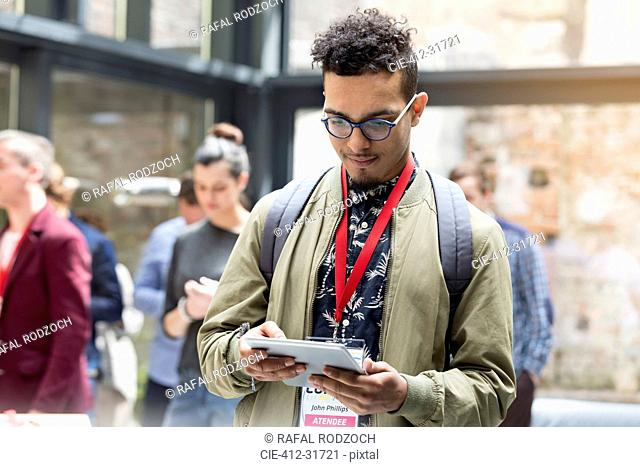 Man using digital tablet at technology conference