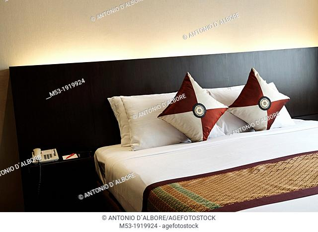 Double bed setting with bed runner and decorated cushions