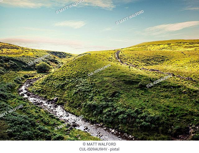 River flowing through rolling landscape, Brecon Beacons, Wales, UK