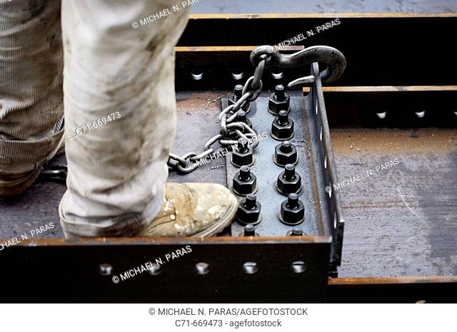 Construction worker boot standing on steel beam