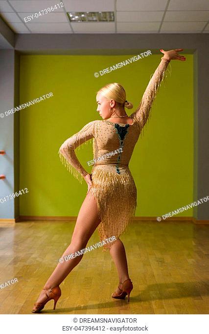 Beautiful woman dancing active ballroom dance in classroom