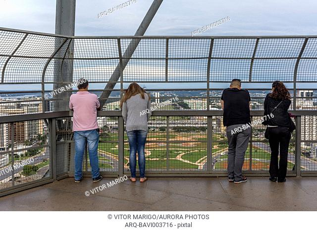 Rear view of group of tourists watching the view from TV Tower in central Brasilia, Brazil