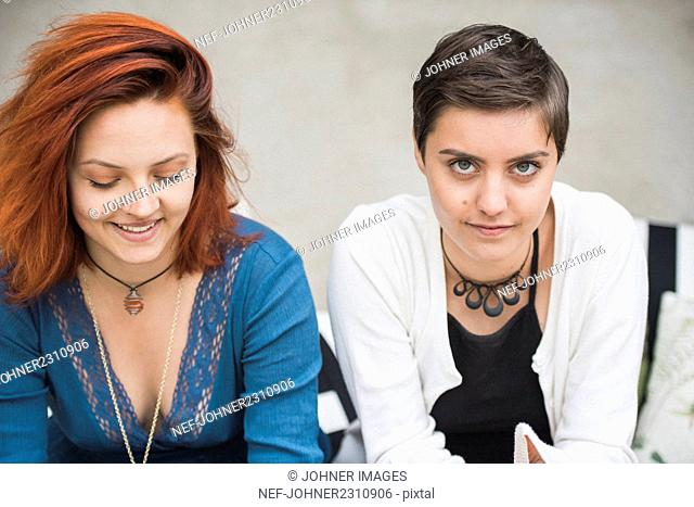 Female friends looking at camera
