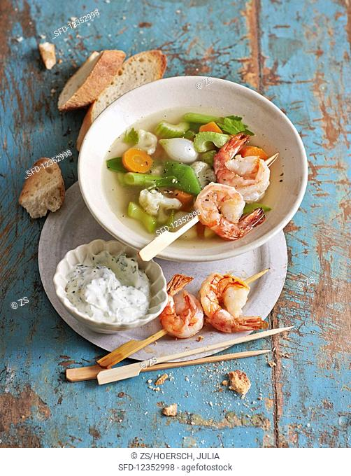Spring vegetables with parsely sour cream and prawns