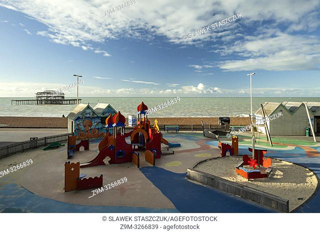 Morning at children's playground on Brighton seafront, East Sussex, England