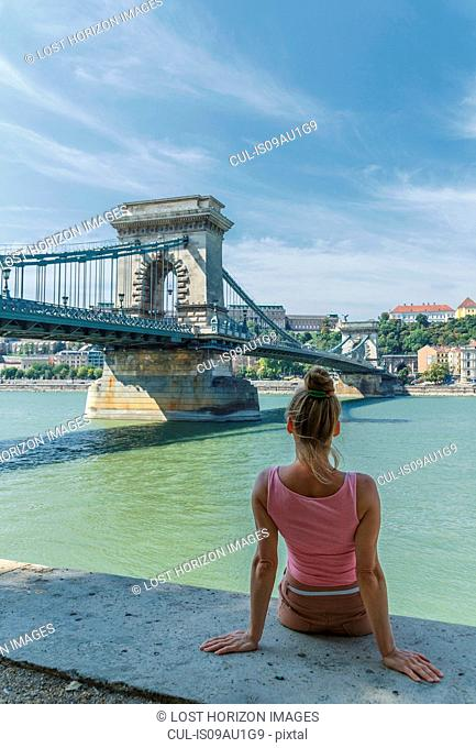Mid adult woman watching The Chain Bridge over the Danube, Budapest, Hungary
