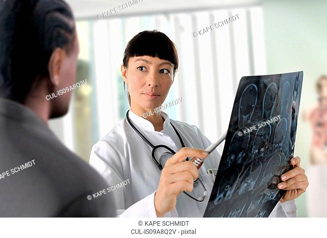 Doctor looking at scans with colleague