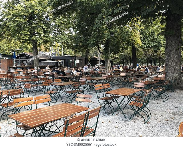 Empty tables and chairs at an outdoor beer garden