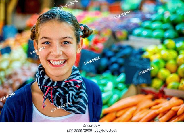 Portrait og young girl on the market