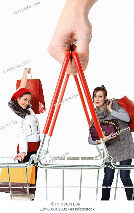 Two women with shopping bags behind giant basket