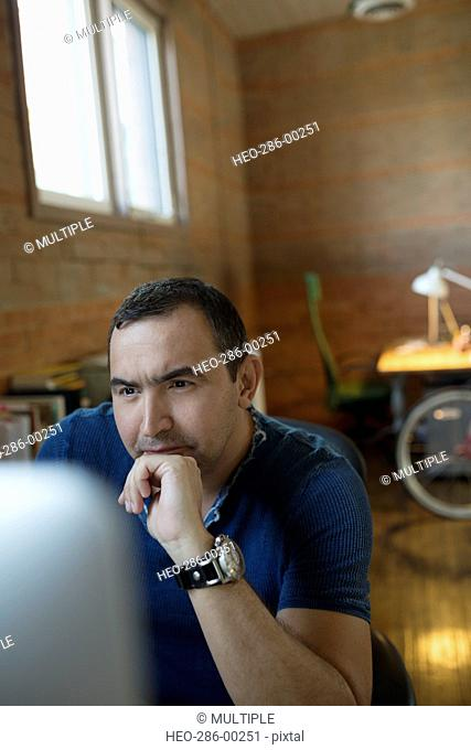 Focused creative businessman working at computer