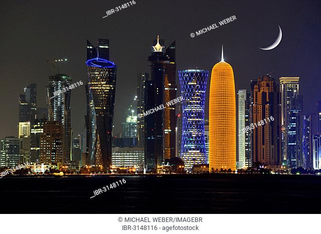 Night skyline of Doha with the Al Bidda Tower, Palm Tower 1 and 2 and the World Trade Center, Tornado Tower, Burj Qatar Tower, golden illumination, moon