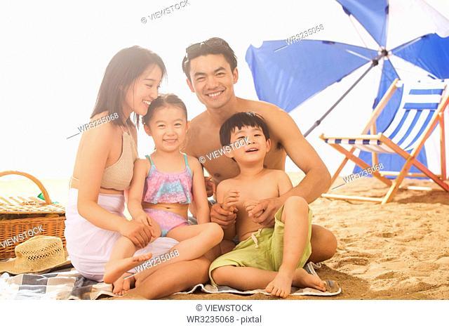 Happy family play on the beach
