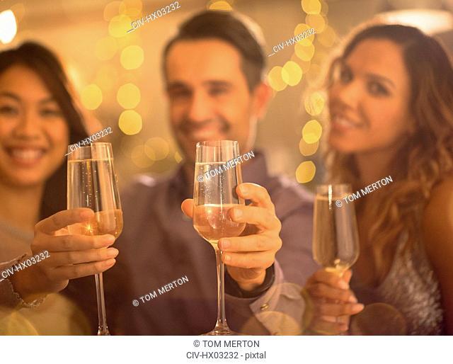 Portrait friends toasting champagne flutes