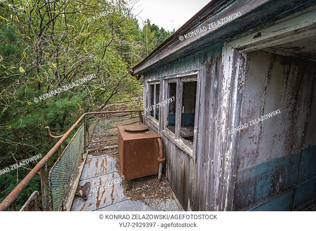 On a deck of sinking boat on a Yanov backwater in Pripyat ghost city of Chernobyl Nuclear Power Plant Zone of Alienation in Ukraine