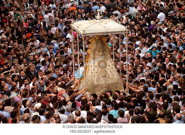 The image of Our Lady of El Rocio is carried by a crow in a procession in El Rocio village, in Almonte, Donana National Park, Huelva province, Andalusia, Spain
