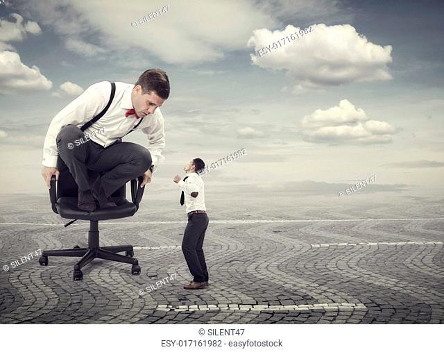 Furious boss yelling at an employee